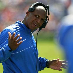 Kentucky head coach Joker Phillips gestures to one of his players during a time out in the second half of an NCAA college football game against Florida, Saturday, Sept. 22, 2012, in Gainesville, Fla. Florida defeated Kentucky 38-0.