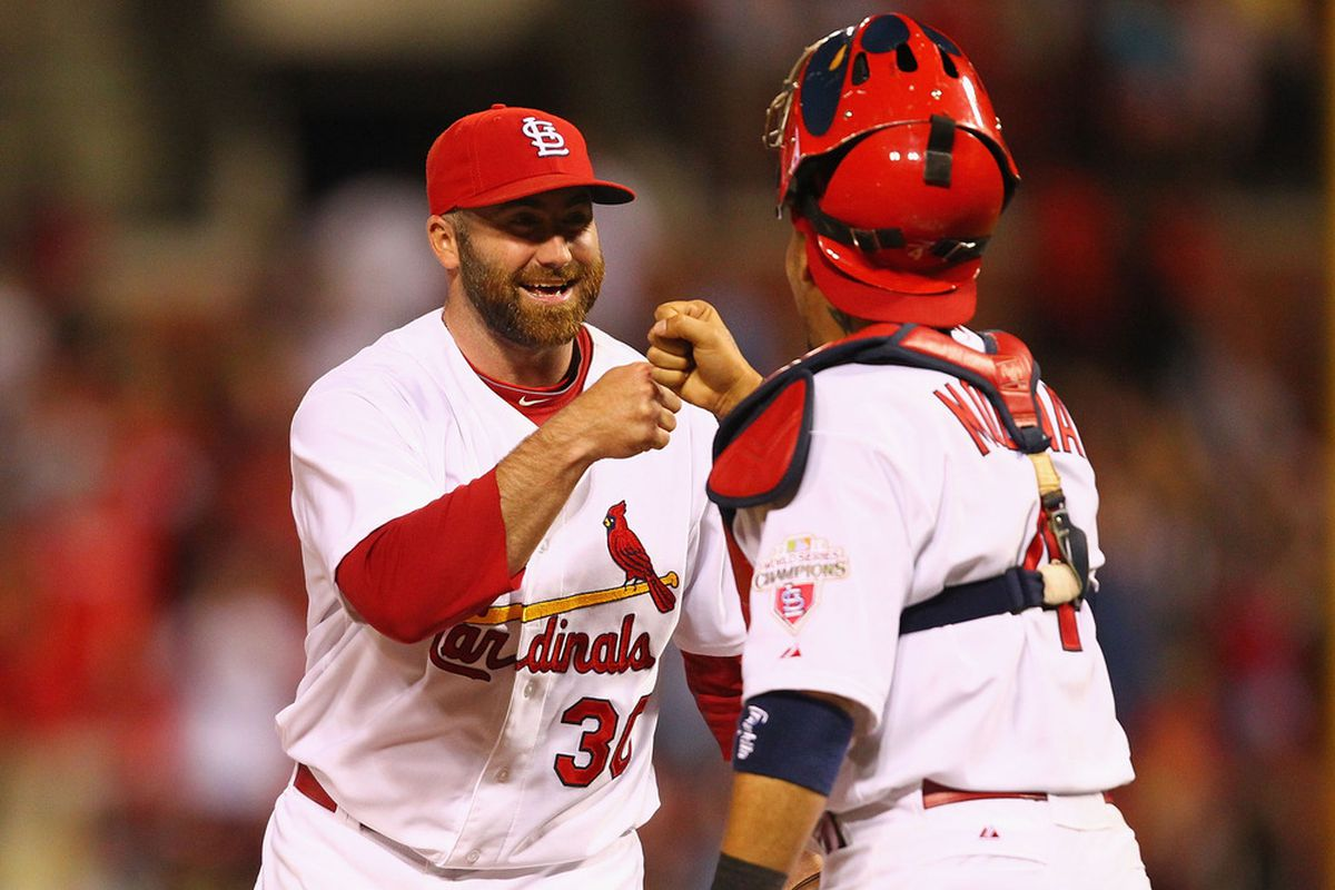 ST. LOUIS, MO - MAY 23: Jason Motte #30 and Yadier Molina #4 both of the St. Louis Cardinals celebrate a victory over the San Diego Padres at Busch Stadium on May 23, 2012 in St. Louis, Missouri.  (Photo by Dilip Vishwanat/Getty Images)