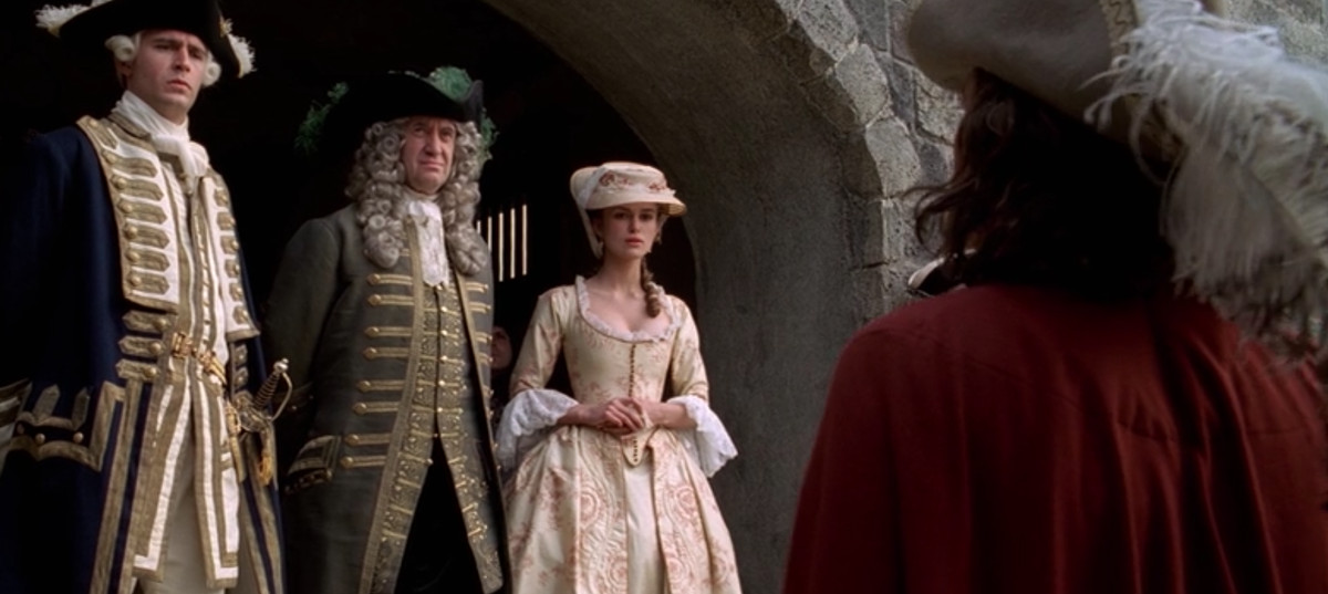 elizabeth in the peach colored dress she wears at the end of curse of the black pearl