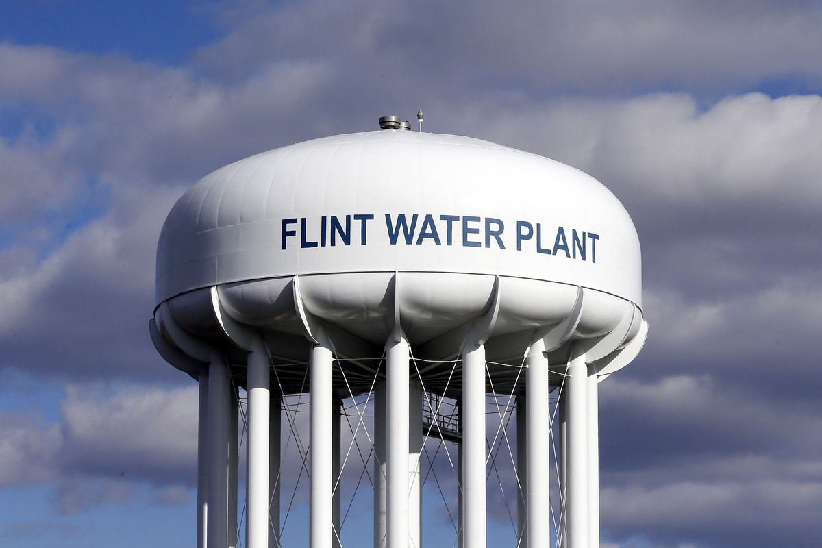 In this March 21, 2016, file photo, the Flint Water Plant water tower is seen in Flint, Mich.