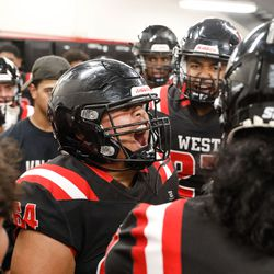 West's Marcus Tua cheers with his teammates before exiting the locker room during a high school football game against Roy High on Friday, Sept. 10, 2021, at West High School in Salt Lake City.