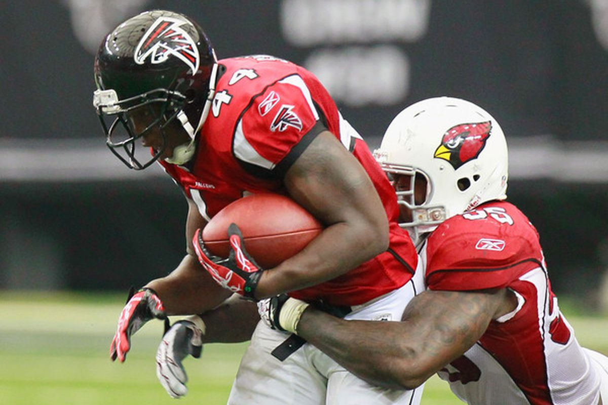 ATLANTA - SEPTEMBER 19:  Jason Snelling #44 of the Atlanta Falcons is tackled by Joey Porter #55 of the Arizona Cardinals at Georgia Dome on September 19 2010 in Atlanta Georgia.  (Photo by Kevin C. Cox/Getty Images)