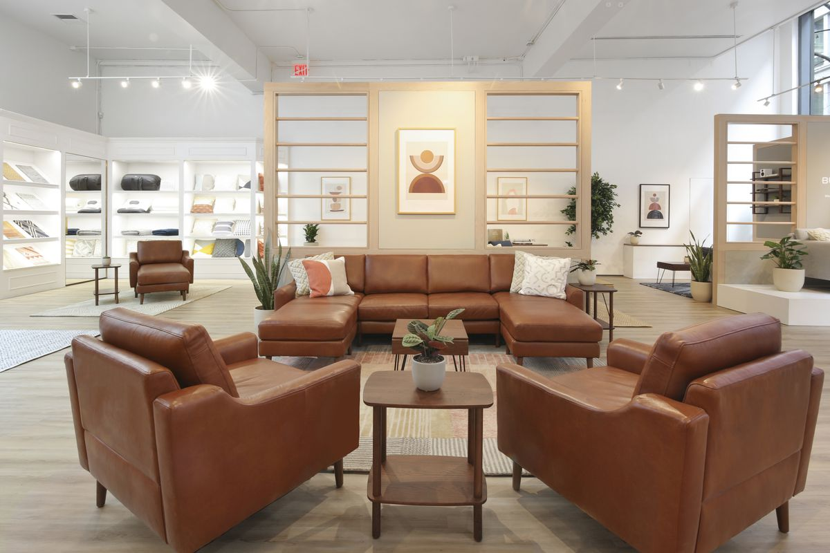 Leather couch and chairs arranged in showroom
