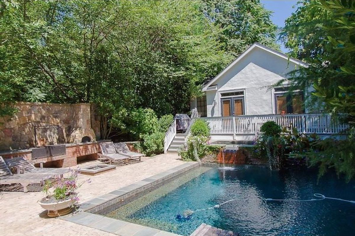 [The pool, grills (plural) and renovated carriage house.]