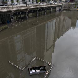 Chicago's Riverwalk sits submerged underwater after rain showers over the weekend, Monday, May 18, 2020.