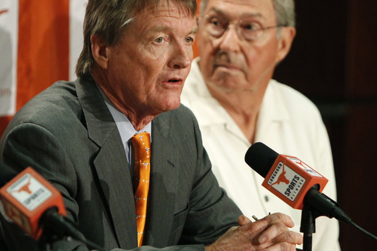 University of Texas at Austin President William Powers Jr., left, and Men's Athletics Director DeLoss Dodds  announce they'll keep the Big XII Conference alive under their benevolent leadership.  (Photo by Erich Schlegel/Getty Images)