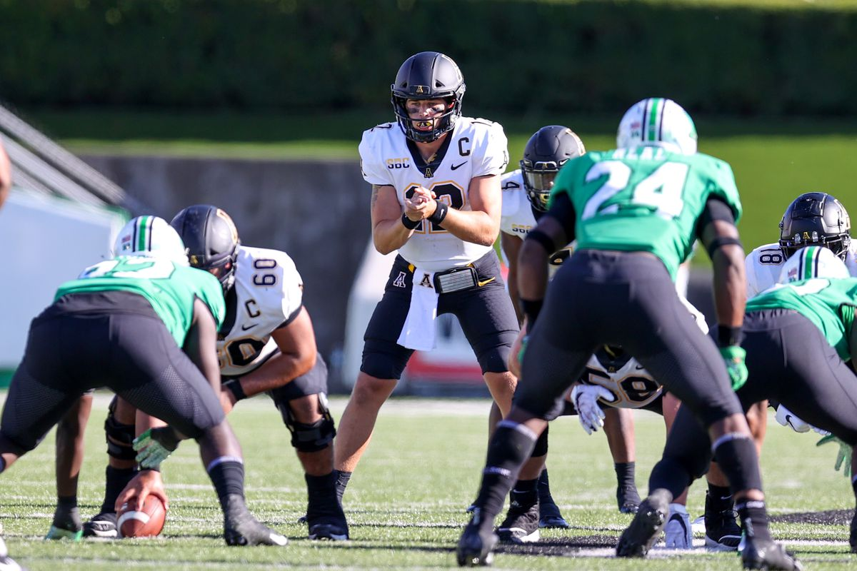 Appalachian State Mountaineers quarterback Zac Thomas (12) prepares to take a snap during the second quarter of the college football game between the Appalachian State Mountaineers and the Marshall Thundering Herd on September 19, 2020, at Joan C. Edwards Stadium in Huntington, WV.