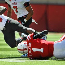 Nebraska's Harvey Jackson (1) gets a hold of Arkansas State's David Oku (25) during their Saturday, Sept. 15, 2012 NCAA football game in Lincoln, Neb.(AP Photo/Dave Weaver)