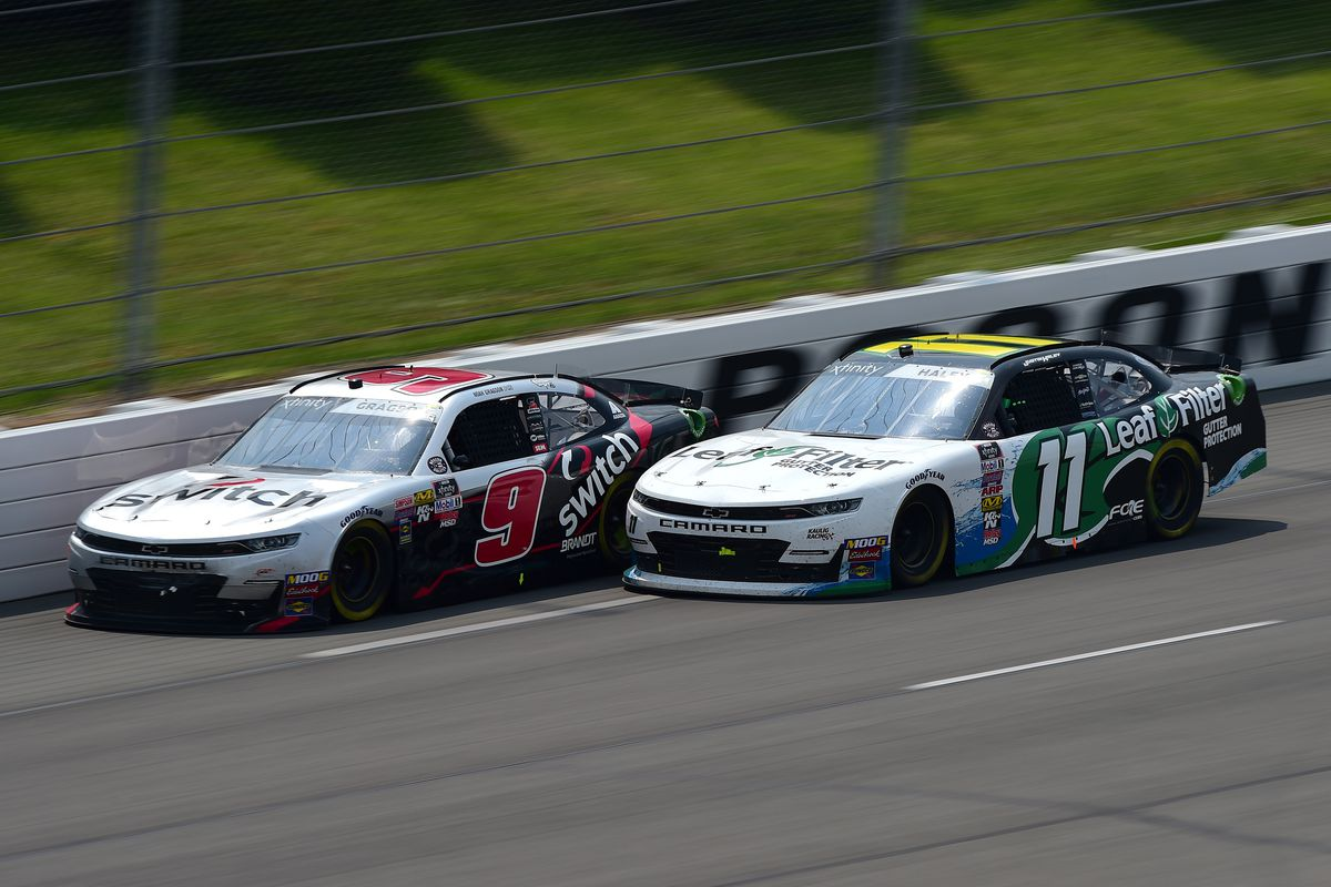 Noah Gragson, driver of the #9 Switch Chevrolet, races Justin Haley, driver of the #11 LeafFilter Gutter Protection Chevrolet, during the NASCAR Xfinity Series Pocono Green 250 at Pocono Raceway on June 01, 2019 in Long Pond, Pennsylvania.
