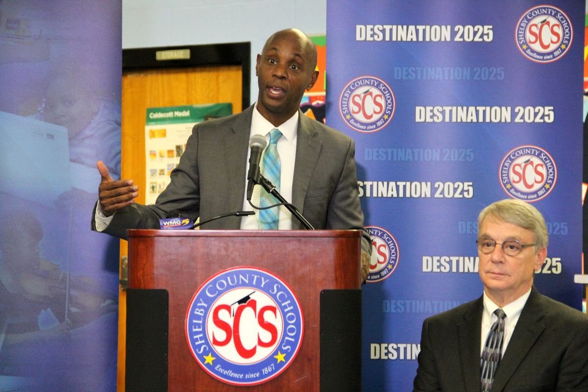 Shelby County Superintendent Dorsey Hopson speaks about the district's funding lawsuit against the state as school board member Chris Caldwell looks on.