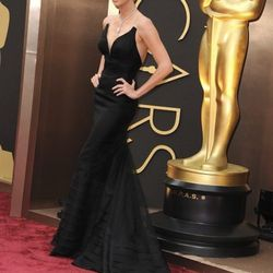 """""""<strong>Charlize Theron</strong>. I really loved this black <strong>Dior</strong> dress. The shape was interesting, very different than everything else we saw that evening. The different layers of fabric and construction made a sculptural effect that mad"""