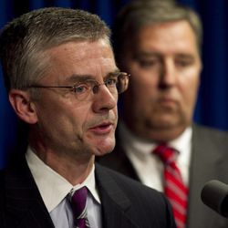 Richard Deslauriers, FBI special agent in charge of the Boston Field Office, left, faces reporters as James Trusty, chief of the organized crime and gang section in the U.S. Justice Department Criminal Devision, right, looks on during a news conference in Providence, R.I., Wednesday, April 25, 2012, held to announce the arrest of alleged New England mafia boss Anthony DiNunzio. The investigation into the alleged shakedown of Providence strip clubs left the New England mafia without a leader on Wednesday as authorities arrested the reputed boss in Boston on charges he oversaw the mob's extortion of adult entertainment businesses and sought to broaden its influence.