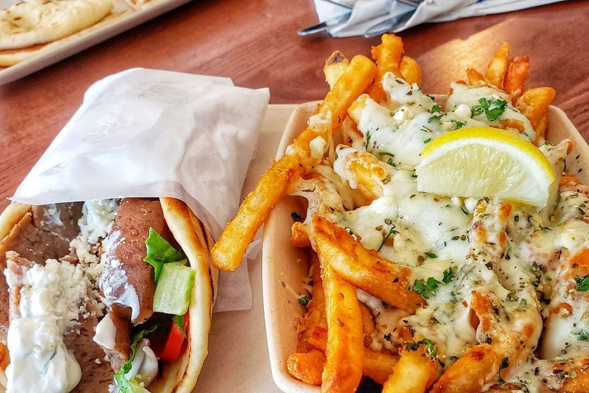 A gyro on the left and feta fries on the right