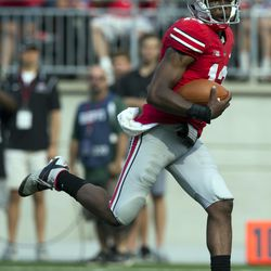 Kenny Guiton takes it to the house.
