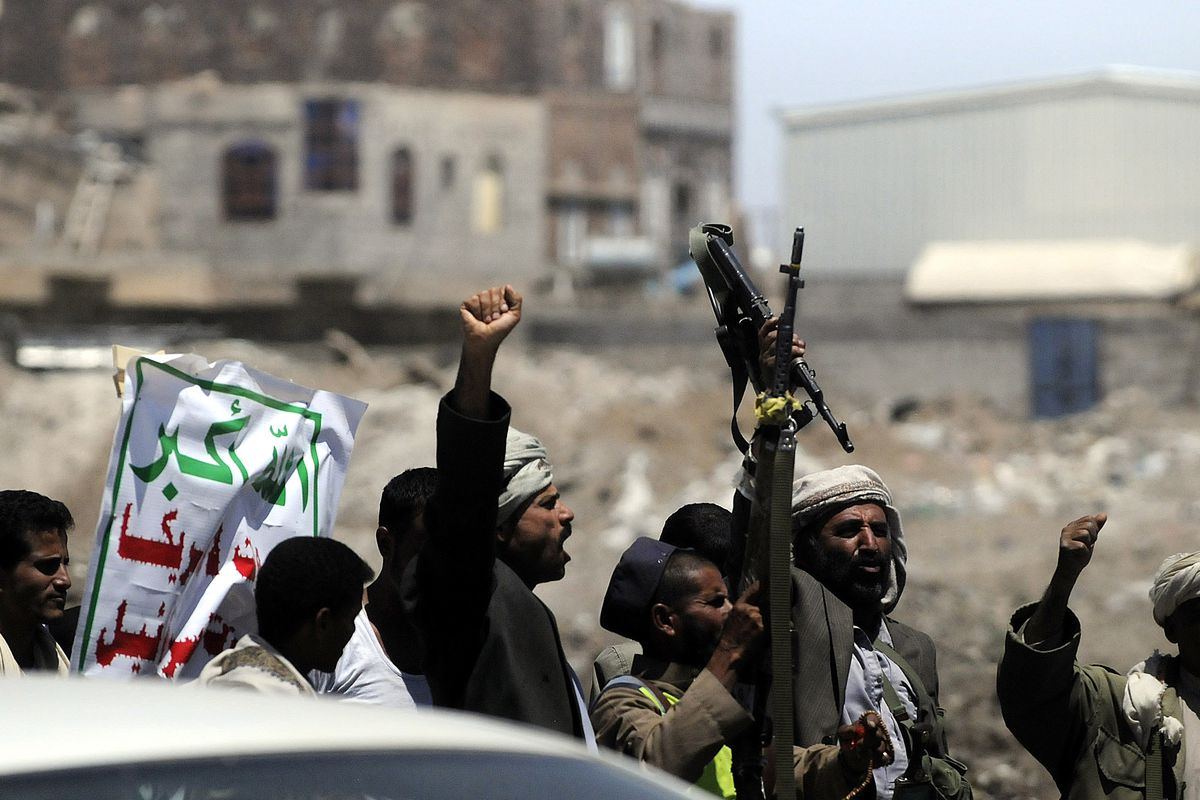 Houthi rebels outside of Yemeni Government TV offices in Sana'a.