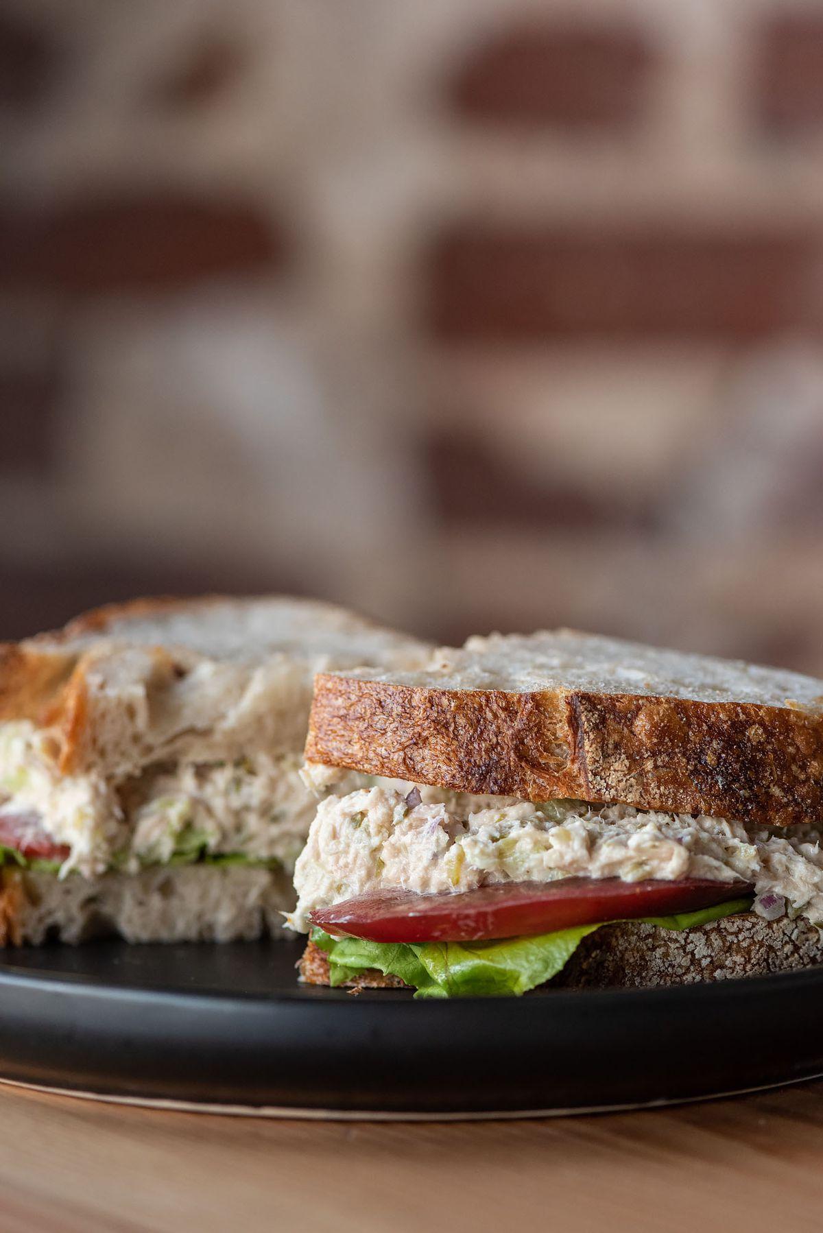 A tomato, lettuce, and tuna salad sandwich.