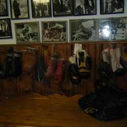 Don Fullmer's basement is a boxing museum with gloves from many of his famous bouts and pictures of the Fullmers' fights and meetings with famous boxers.