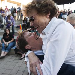 Cody Partridge hugs another woman during a same sex marriage celebration at Library Square in Salt Lake City, Monday, Oct. 6, 2014.