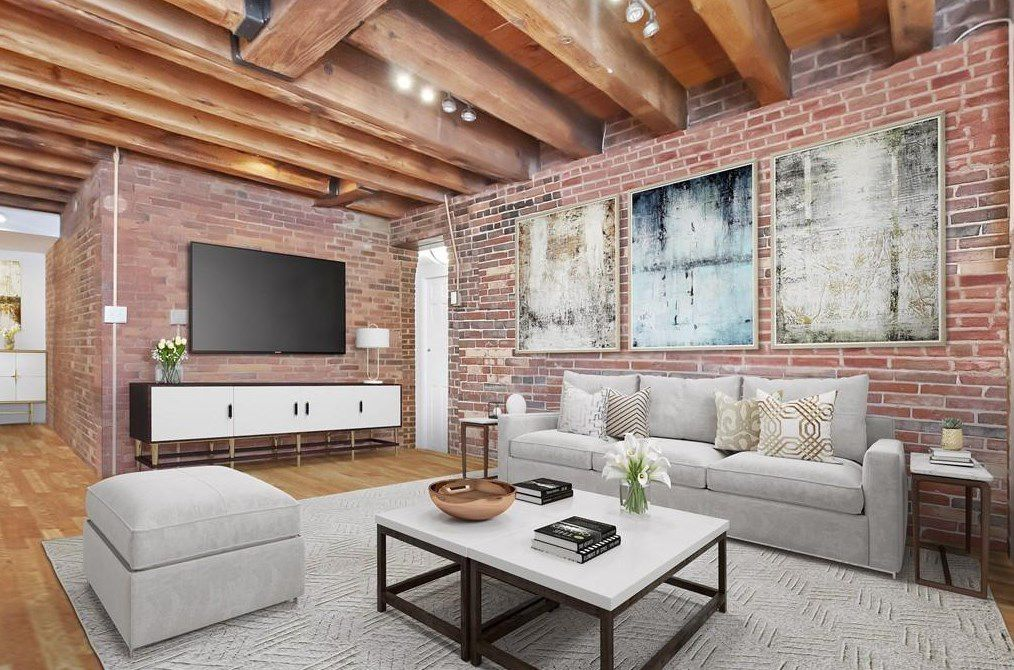 Another shot of that open living room, with plenty of exposed brick visible via the walls.