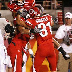 University of Utah's Freddie Brown (88) and Bradon Godfrey (81) congratulate Colt Sampson on his touchdown against the University of Nevada-Las Vegas.