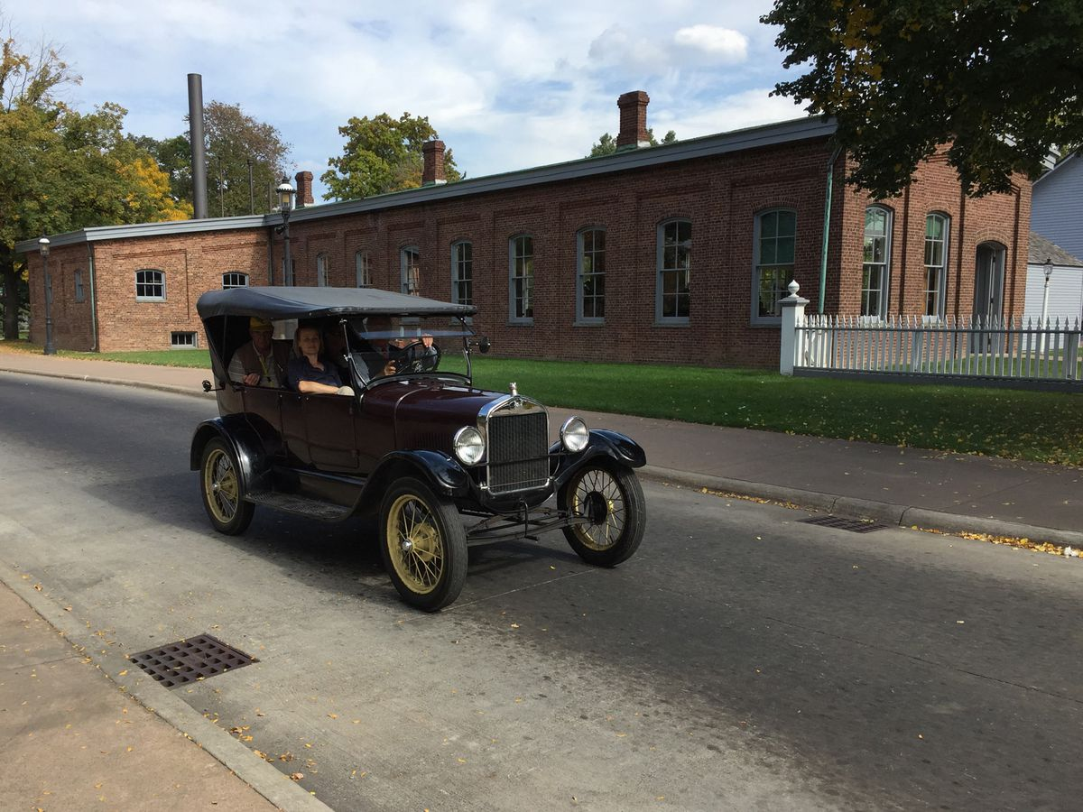 Visitors to Henry Ford's Greenfield Village can pay $2 to go for a ride in a historic Model T.