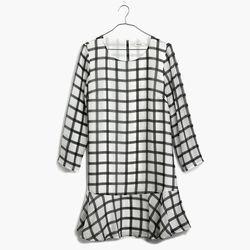"Madewell silk ruffle-hem dress, <a href=""https://www.madewell.com/madewell_category/DRESSES/shiftdresses/PRDOVR~B5775/B5775.jsp?color_name=tide-water"">$168</a>"