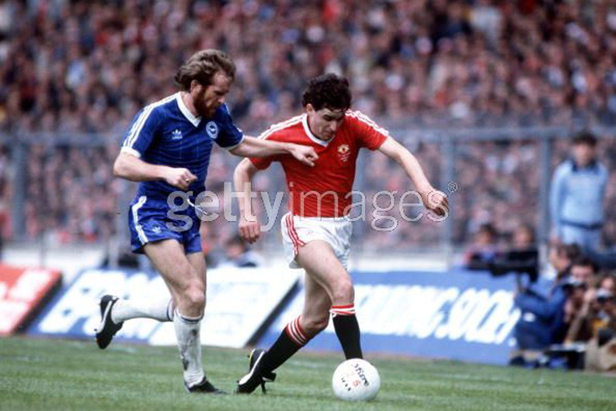 Arthur Albiston in flight for United. This pic does not do his hair justice.
