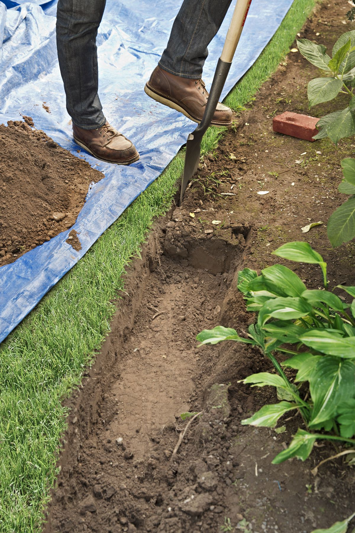Man Digs Trench For Brick Edging