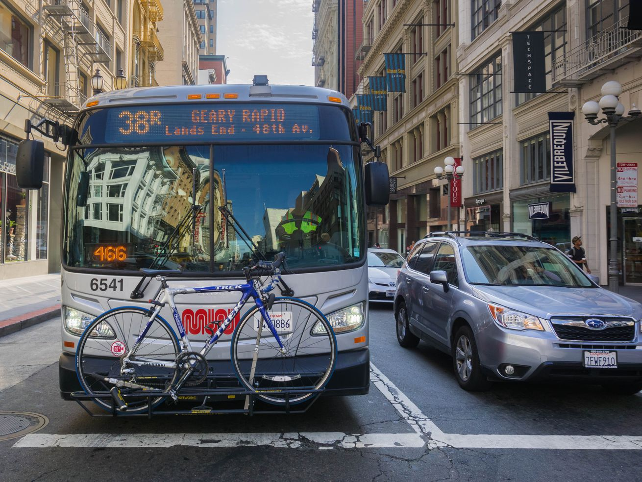 A Muni bus carries a bicycle through downtown San Francisco. Since last year, the state's transportation emissions have increased two percent.