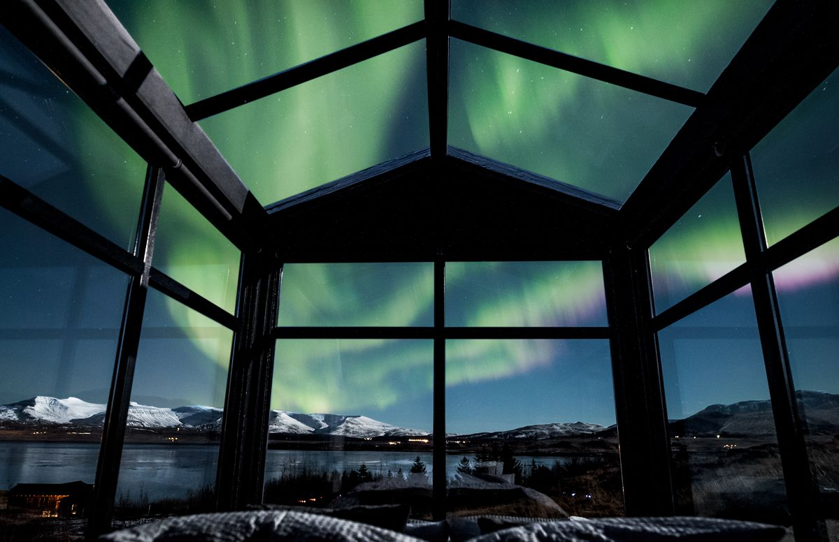Windows looking out onto the Northern Lights