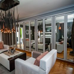 """The wall of mirrors are actually closet doors. The house is 8,000+ sq. ft. but there's no such thing as too much storage. [Photo by <a href=""""http://www.patriciachangphotography.com/"""">Patricia Chang</a>]"""