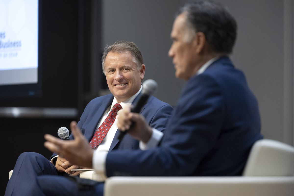 University of Utah President Taylor Randall, left, listens to Utah GOP Sen. Mitt Romney during a discussion at the inaugural Fintech Summit at the Garff Executive Education Building at the U. in Salt Lake City on Friday, Sept. 17, 2021.