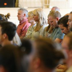 People meditate as they listen to Thomas McConkie of Lower Lights in Salt Lake City on Wednesday, June 14, 2017.