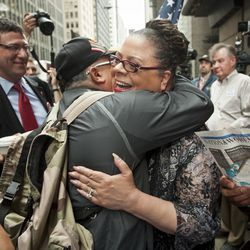 Chicago Teachers Union President Karen Lewis is hugged by a supporter outside Chicago Board of Education headquarters at 125 S. Clark St. before the board votes to close public schools across the city in 2013.