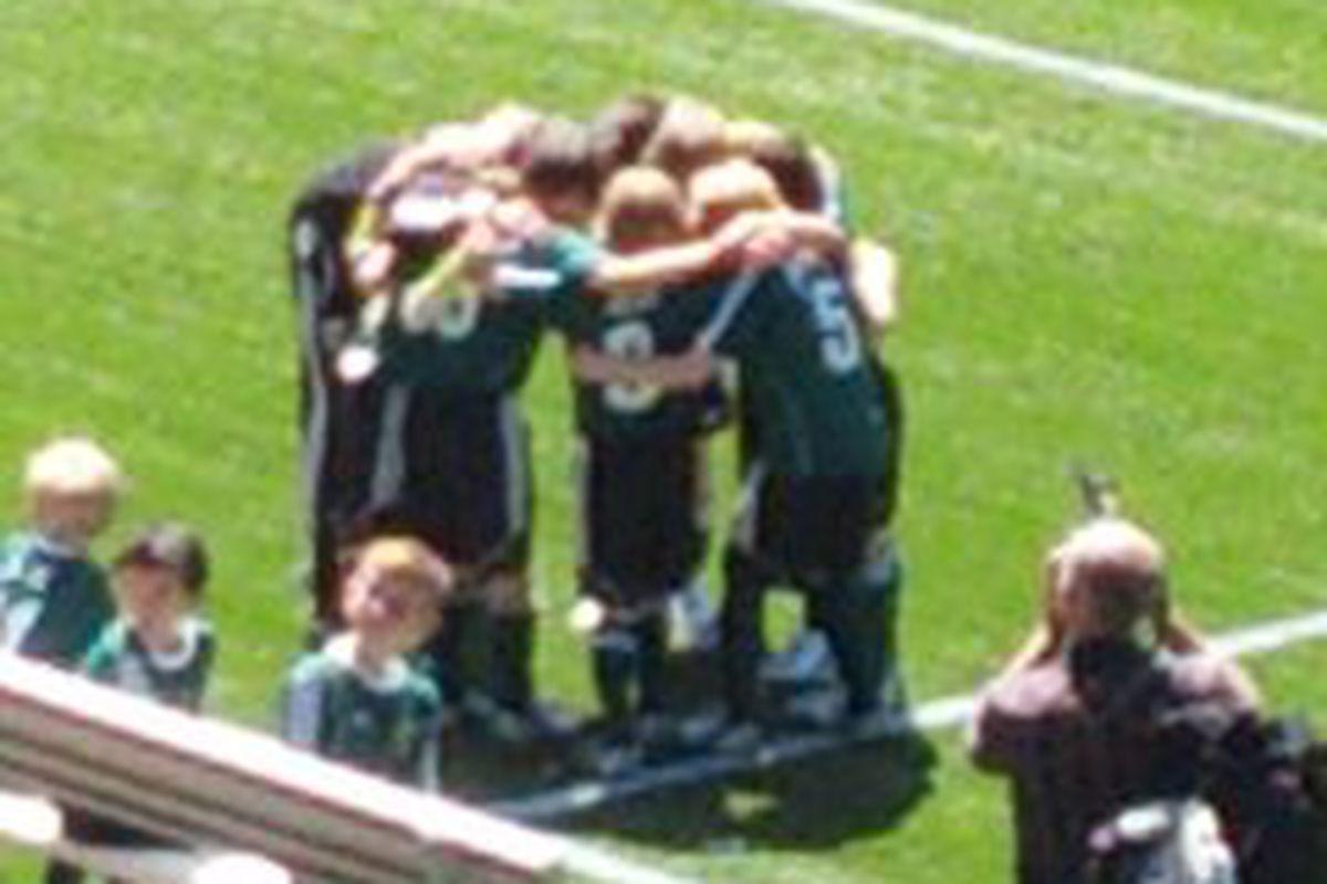 The Green Machine pre-match huddle
