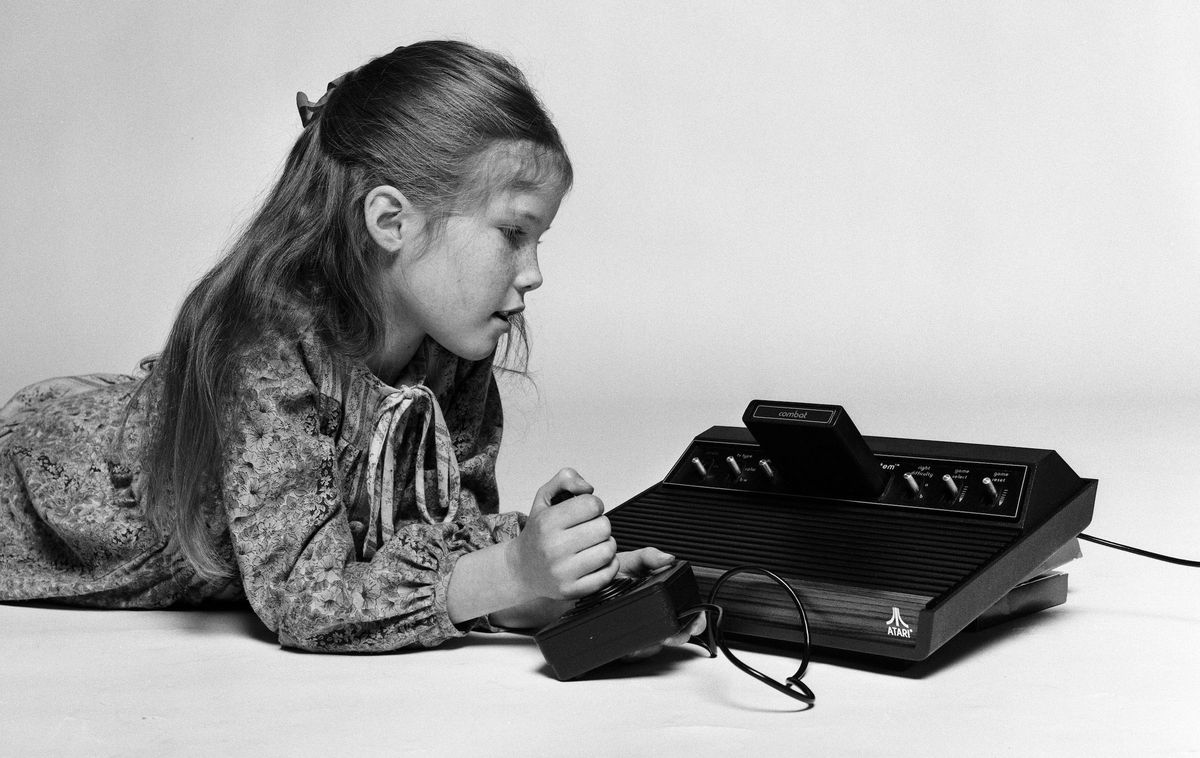 A young girl playing on the Atari 2600