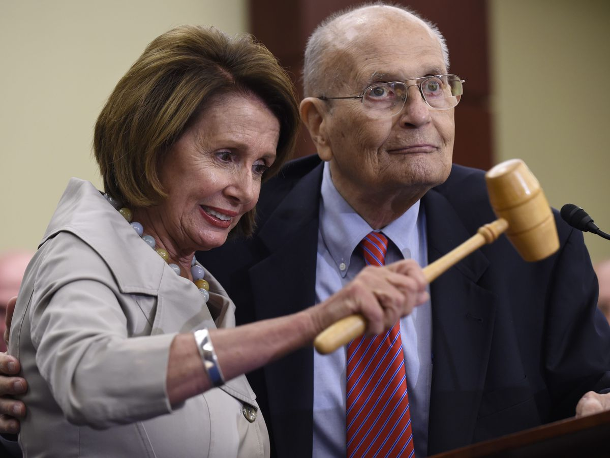 In this July 29, 2015 file photo, House Minority Leader Nancy Pelosi of Calif., standing with former Rep. John Dingell, D-Mich., holds up the gavel Dingell used 50 years ago when Medicare legislation was passed during an event marking the 50th Anniversary