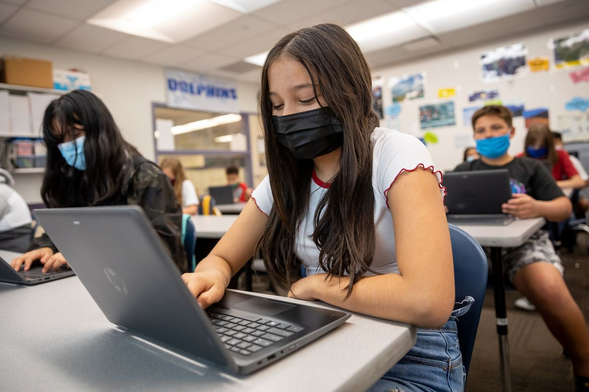 Aubrianna Trujilo and classmates wear masks while working in their sixth grade class at Nibley Park School in Salt Lake City.