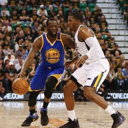 Golden State Warriors forward Draymond Green #23 attempts to drive past Utah Jazz forward Joe Johnson #6 during game four of the Western Conference Semifinal at Vivant Smart Home Arena in Salt Lake City on Monday, May 8, 2017.