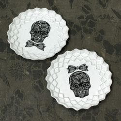 """His and Hers <b>Patch NYC</b> Skull Dessert Plates, <a href=""""http://www.patchnyc.com/products/skull-dessert-plates-sscptc1"""">$76</a> each"""