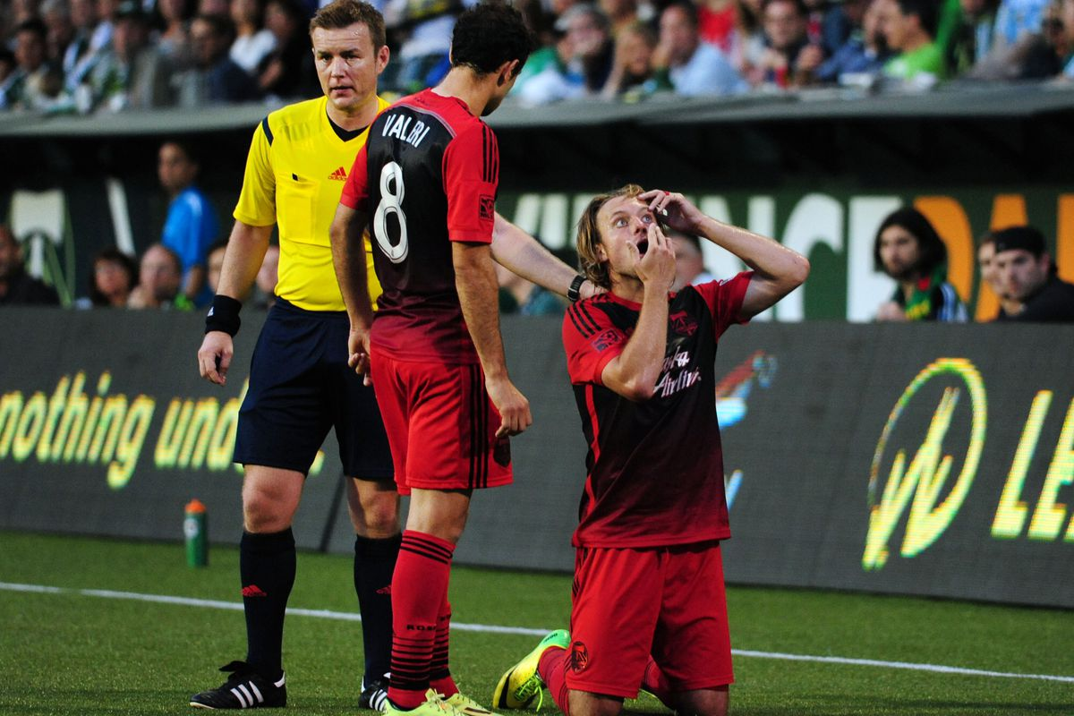 Portland Timbers defender/midfielder Michael Harrington (5) tries to put his contact lens back in as FC Dallas forward Blas Perez (7) waits during the second half at Providence Park.