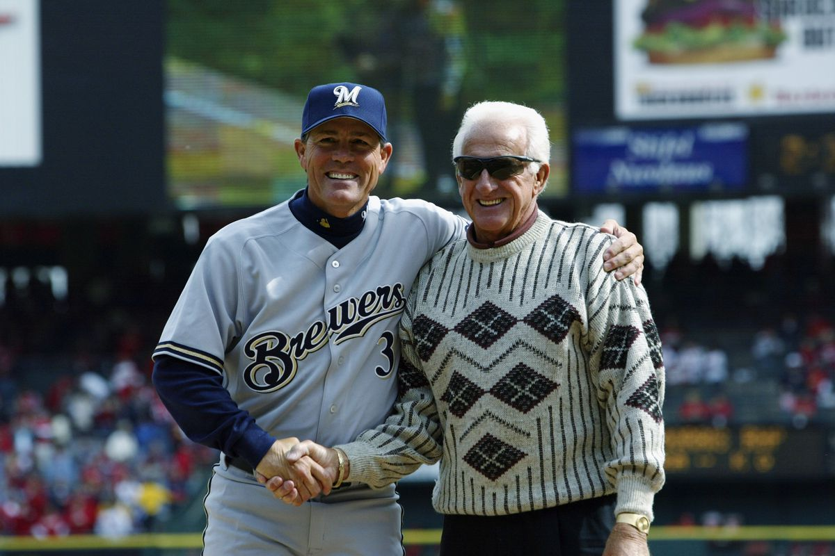 Ned Yost shakes hands with Bob Uecker