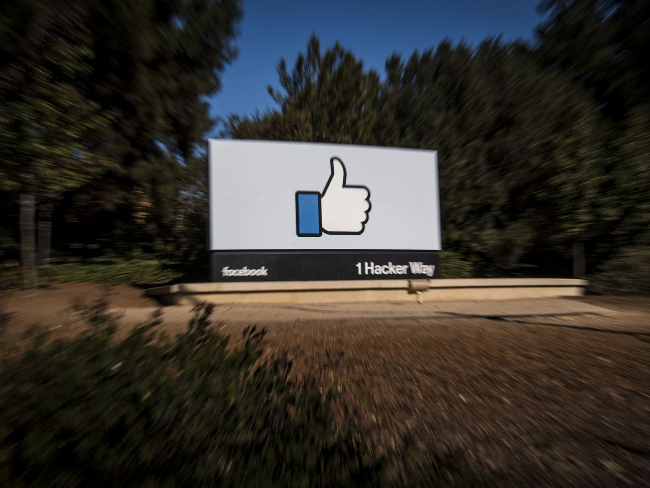 "Signage of a ""like"" thumbs-up is displayed outside Facebook's headquarters in Menlo Park, California, in 2018"