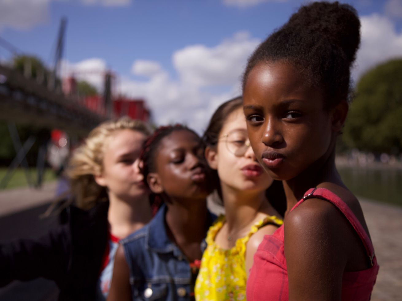 Four girls stand in a line.
