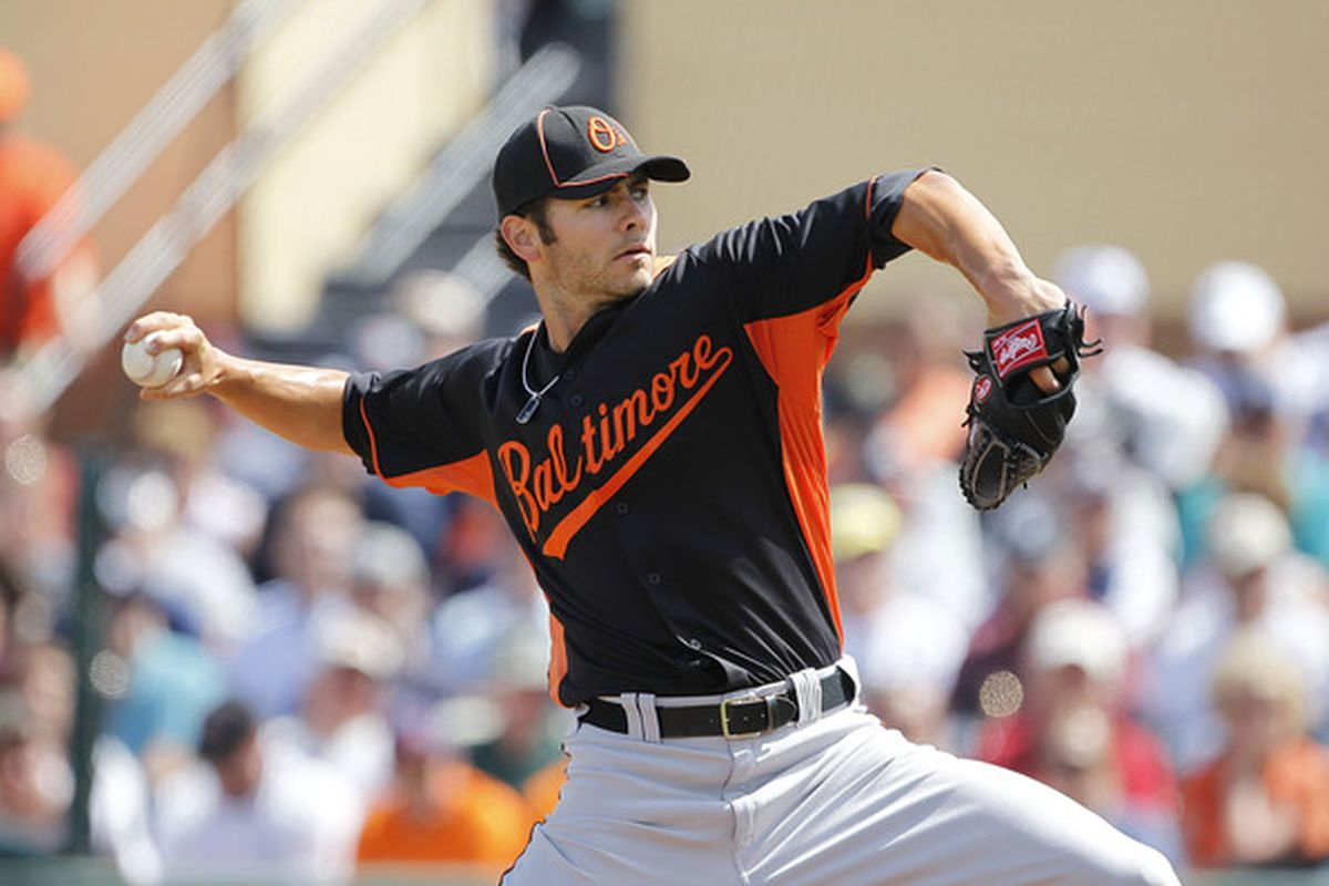 LAKELAND, FL - MARCH 04: Jake Arrieta of the Baltimore Orioles pitches during the game against the Detroit Tigers at Joker Marchant Stadium on March 4, 2011 in Lakeland, Florida.(Photo by Leon Halip/Getty Images)