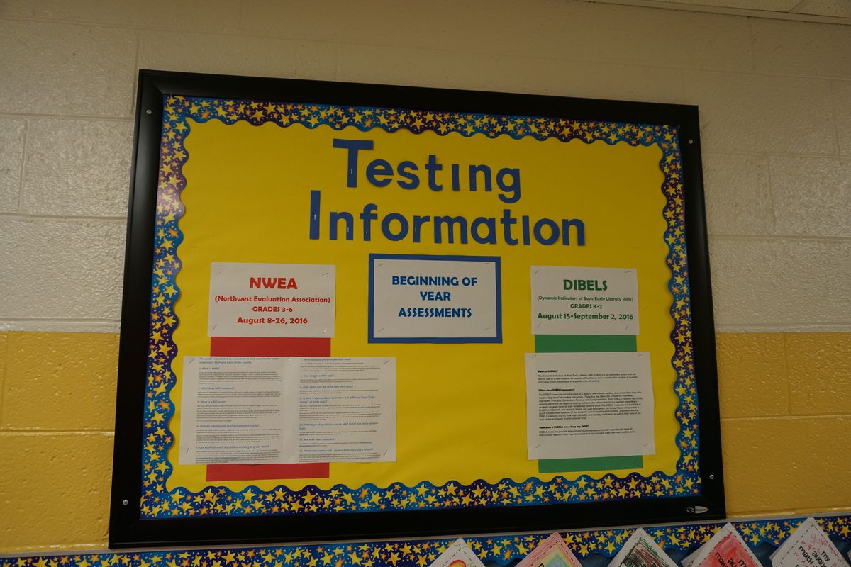 A bulletin board at IPS School 55 details information about testing.
