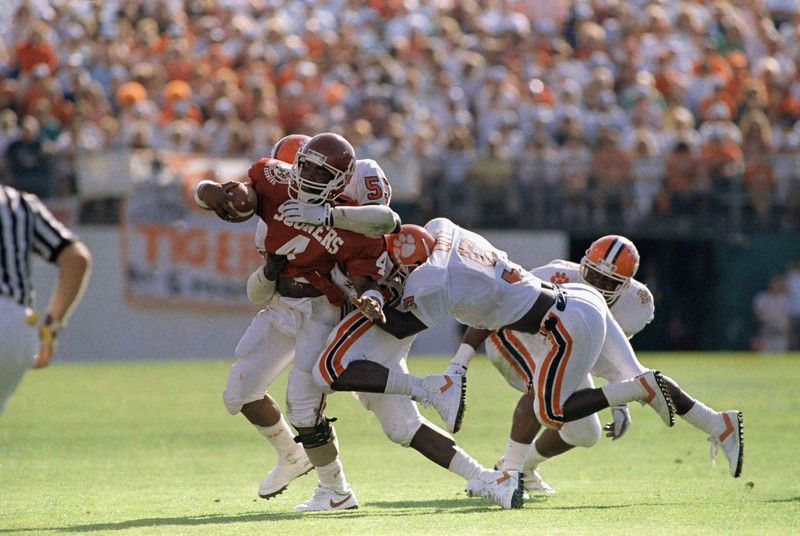 """Sooner QB Jamelle Holiway couldn't escape the tenacious Tiger """"D"""" (photo fromhttp://www.postandcourier.com/article/20141210/PC20/141219919)"""