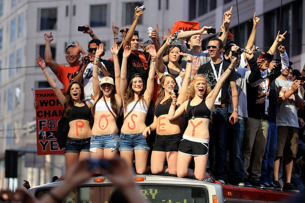 SAN FRANCISCO - NOVEMBER 03:  Buster Posey fans wave for him during the San Francisco Giants victory parade on November 3 2010 in San Francisco California.  (Photo by Ezra Shaw/Getty Images)