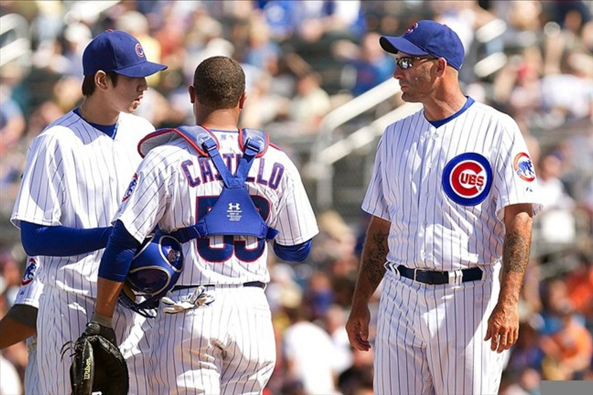 Chicago Cubs manager Dale Sveum, catcher Welington Castillo and pitcher Dae-Eun Rhee talk on the mound against the Oakland Athletics during a spring training game at HoHoKam Park.  Credit: Allan Henry-US PRESSWIRE