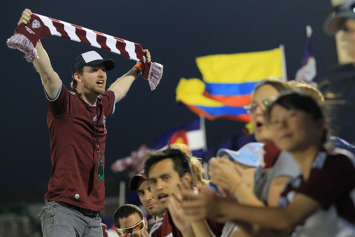 COMMERCE CITY, CO - MAY 26:  The Bulldog Supporters Group sing for the Colorado Rapids as they defeated the Montreal Impact 3-2 at Dick's Sporting Goods Park on May 26, 2012 in Commerce City, Colorado.  (Photo by Doug Pensinger/Getty Images)